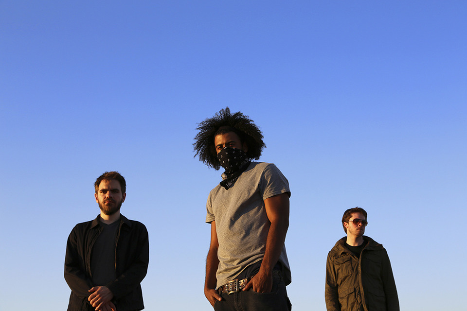 The hip-hop trio Clipping: producers Jonathan Snipes (left) and William Hutson flank rapper Daveed Diggs.