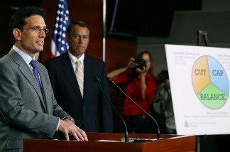 Majority Leader Eric Cantor (R-VA) (L) speaks while House Speaker John Boehner (R-OH) (C) listens during a news conference at the U.S. Capitol, on July 19, 2011 in Washington, DC.