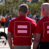 Same-sex marriage supporters wear equality shirts while celebrating the U.S Supreme Court ruling regarding same-sex marriage on June 26, 2015 in San Francisco, California. The high court ruled that same-sex couples have the right to marry in all 50 states.
