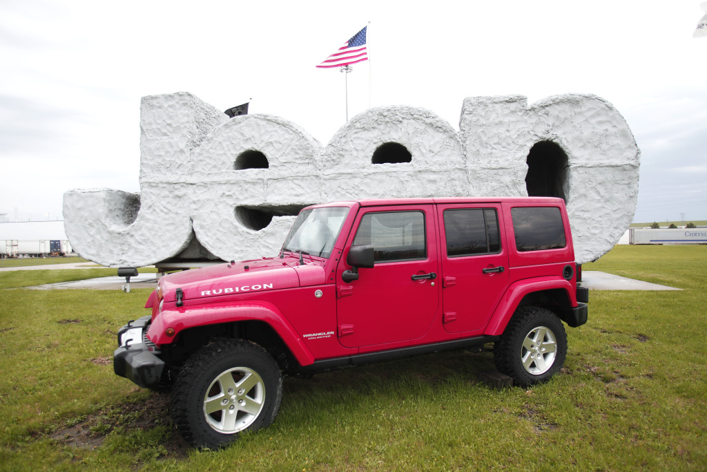 TOLEDO, OH - MAY 7:  A 2014 Jeep Wrangler sits in front of a Jeep sign at the Chrysler Toledo North Assembly Plant where Jeep Wranglers and Cherokees are assembled May 7, 2014 in Toledo, Ohio. Fiat Chrysler Automobiles announced it wants to turn Jeep into a global brand as part of an aggressive five-year plan. The automaker also plans on bringing back the Alfa Romeo to the U.S.  (Photo by Bill Pugliano/Getty Images)