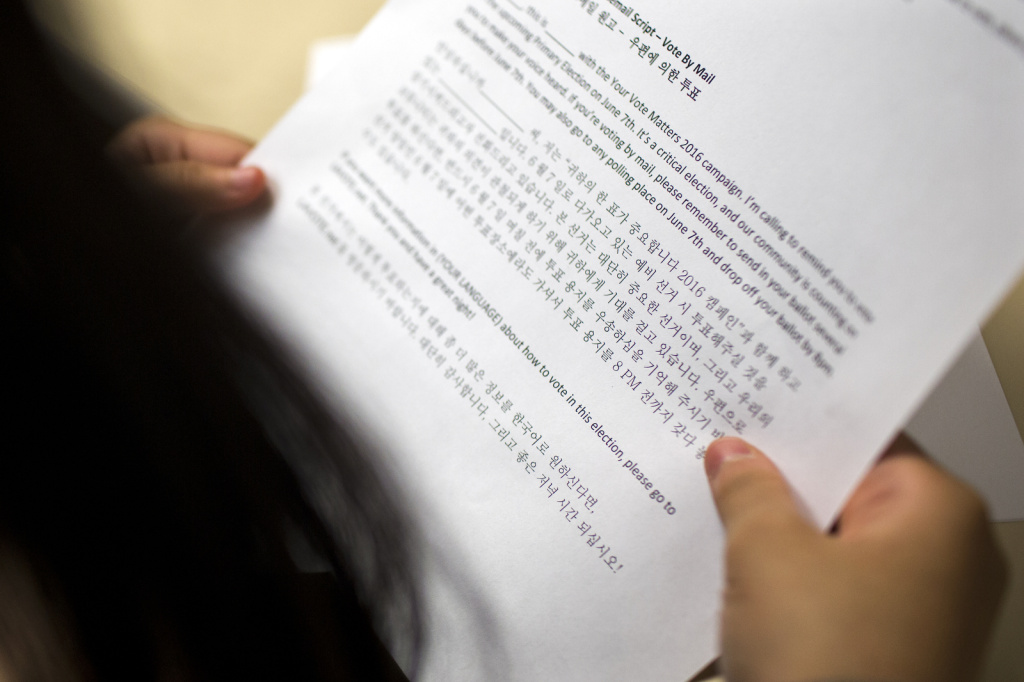 A student from the Los Angeles Center for Enriched Studies looks at a Korean call script during a phone bank shift reminding people to vote in the upcoming primary election at the Asian Americans Advancing Justice Los Angeles on Monday evening, May 23, 2016. The center works in partnership with 20 different organizations to run the phone bank.