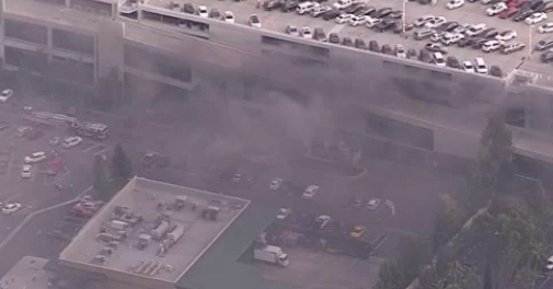 Seven people were treated for smoke inhalation Monday after a fire at Disneyland's Mickey and Friends parking structure completely torched or damaged at least eight vehicles, according to the Anaheim Police Department.