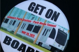 Supporters of a Leimert Park Village stop on the Metro's proposed Crenshaw light rail wear these pins.