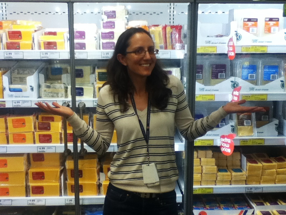 KNX reporter and grilled cheese judge Claudia Peschiutta in the dairy aisle at Fresh n' Easy on Lake Ave.