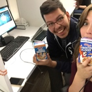 Off-Ramp interns Jesus Ambrosio and Rosalie stand by their favorite cereals. (Rosalie Atkinson/KPCC)