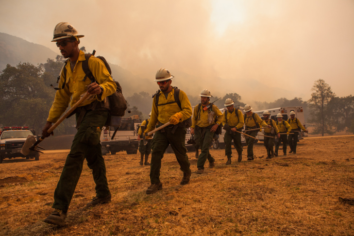 The Lone Peak Hotshots maintain a fire line in Hidden Valley, Calif., on May 3, 2013.