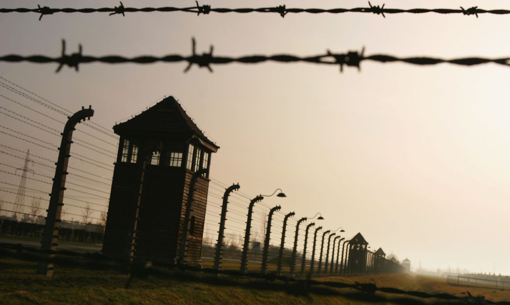 Watch towers surrounded by mulitiple high voltage fences at Auschwitz II