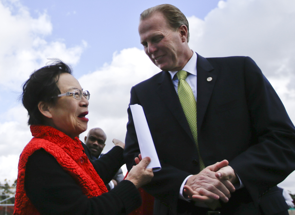 In a Monday, Feb. 3, 2014 photo, San Diego mayoral candidate Kevin Faulconer engages in conversation with supporter Lilly Cheng during a campaign event, in San Diego. Faulconer easily topped a field of 11 candidates in a first round of voting by dominating in wealthier neighborhoods north of the freeway. (AP Photo/Lenny Ignelzi)