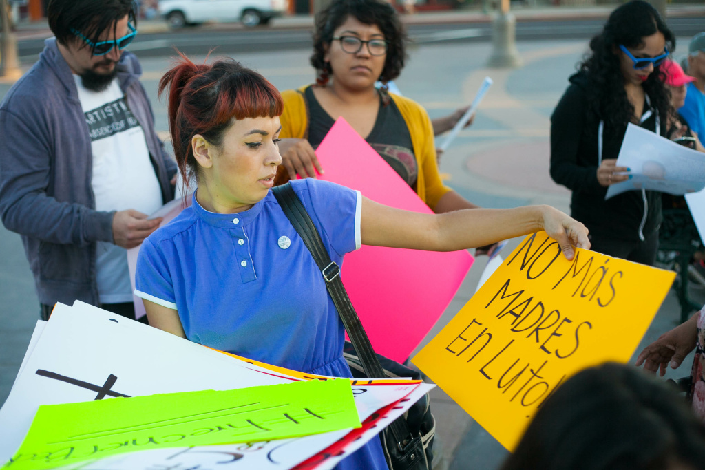 Maryann Aguirre helped to organize a vigil and protest against police violence for Jesse Romero in Boyle Heights, Calif. on Wednesday, Aug. 10, 2016.