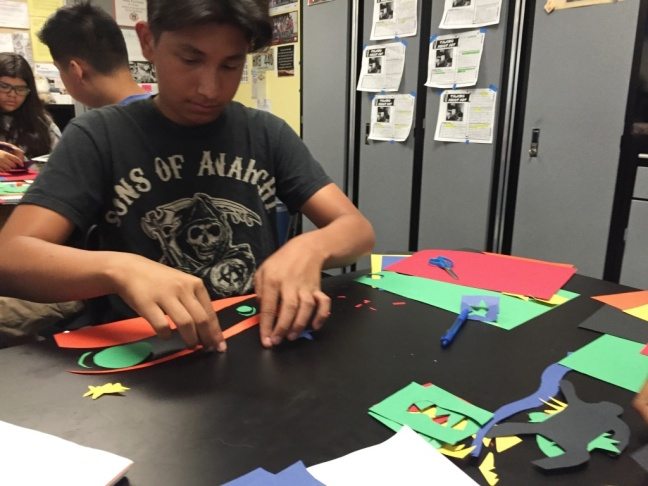 Mario Vasquez, an eighth grader at Fulton & Alsbury Academy of Art and Engineering, works on a cutout project in the style of Henri Matisse.