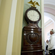 Still Right Twice A Day: Visitors look at the Ohio Clock outside the Senate chamber on Capitol Hill Sunday. The clock that has stood watch over the Senate for 196 years stopped running shortly after noon Wednesday. Employees who wind the clock weekly were
