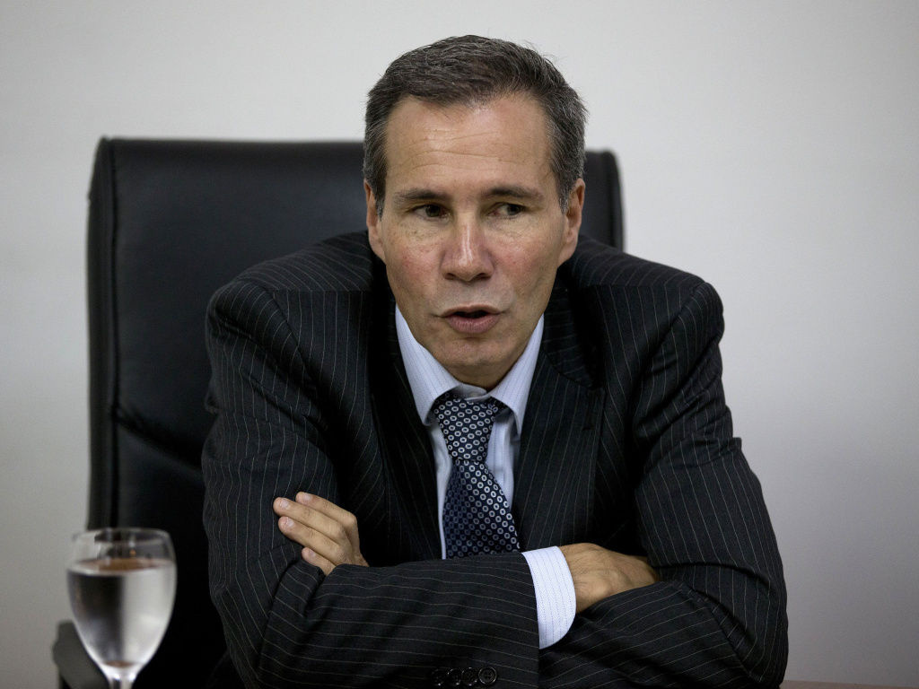 Alberto Nisman, the prosecutor investigating the 1994 bombing of the Argentine-Israeli Mutual Association community center, talks to journalists in Buenos Aires, Argentina in 2013. Nisman was found shot dead in his apartment on Sunday.