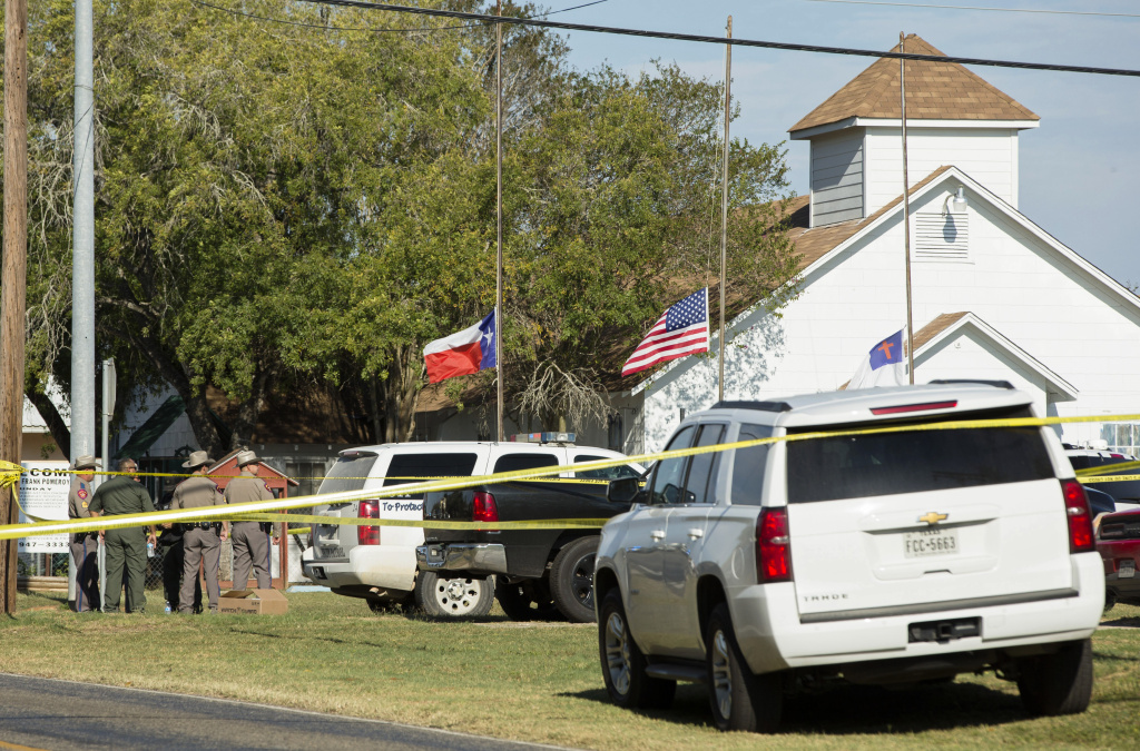 Law enforcement officials gather near the First Baptist Church following a shooting on November 5, 2017 in Sutherland Springs, Texas.