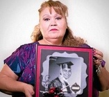 Margaret Gutierrez-Ramirez, of West Covina, holds a picture of her son, Antonio