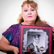 "Margaret Gutierrez-Ramirez, of West Covina, holds a picture of her son, Antonio ""Tony"" Ramirez, during an interview at the San Gabriel Valley Tribune on Tuesday, Nov. 18, 2014. (Photo by Watchara Phomicinda/ San Gabriel Valley Tribune)"