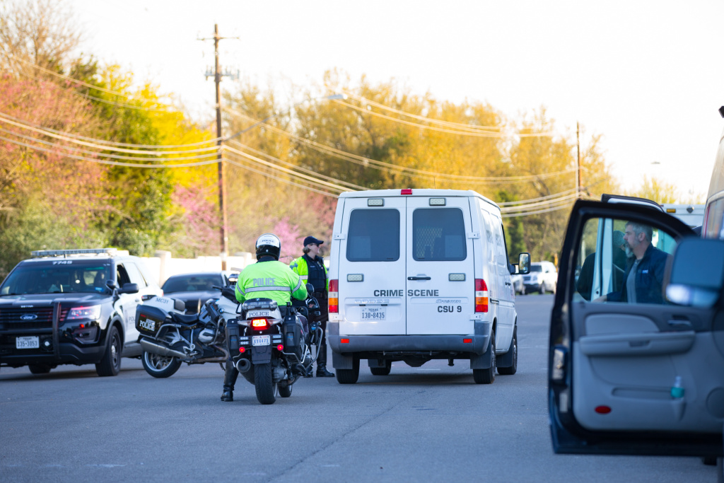 Crime Scene vehicles and local law enforcement work the scene of a bombing on March 19, 2018, near the 4800 block of Dawn Song Drive in Austin, Texas.