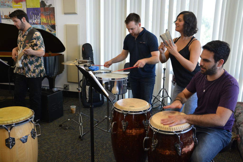 Members of the CalArts Salsa Band in rehearsal. (L-R): Josh Turner, bass; Carson Schafer, timbales; Emilia Moscoso, cowbell; Marcelo Bucater, congas.
