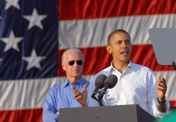 U.S. President Barack Obama (R) speaks with supporters as U.S. Vice President Joe Biden (L) sits by at the Moving America Forward rally October 10, 2010 in Philadelphia, Pennsylvania. Obama and Biden are urging Democrats to come out and vote in the November 2, 2010 general election.