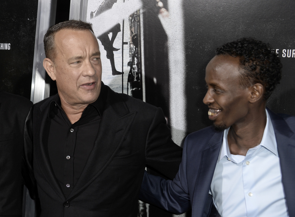 Actors Tom Hanks and Barkhad Abdi arrive at the premiere of Columbia Pictures'