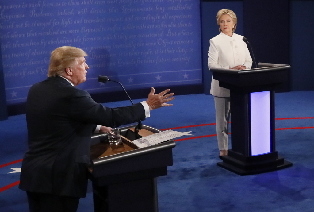 Republican nominee Donald Trump gestures as Democratic nominee Hillary Clinton looks on during the final presidential debate.