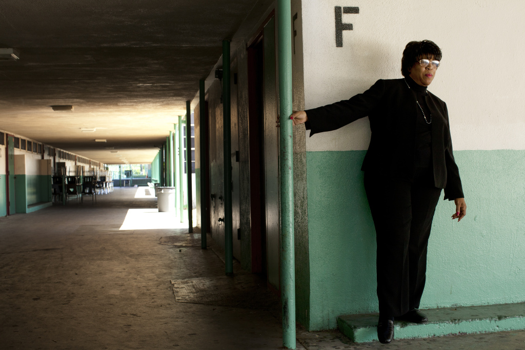 Joyce Randall stands in the hallway near her old classroom at Inglewood High School.