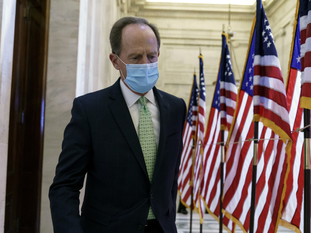 Sen. Pat Toomey, R-Pa., is at the center of a fight over the last major issue standing in the way of a $900 billion COVID relief agreement.
