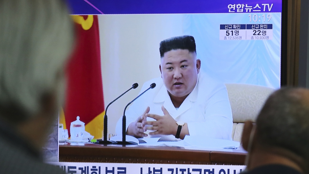 People watch a TV showing a file image of North Korean leader Kim Jong Un during a news program at the Seoul Railway Station in Seoul, South Korea, on June 24, 2020.
