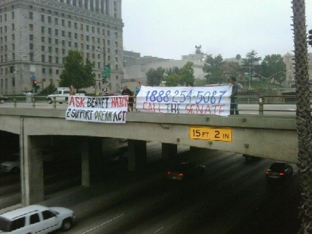 DREAM Act supporters hang a banner over the 101 Freeway downtown before the Senate vote last Tuesday, September 21, 2010