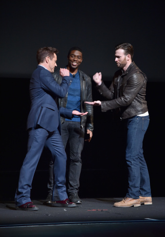 Actors Robert Downey Jr. (L) and Chris Evans onstage during Marvel Studios fan event at The El Capitan Theatre on Oct. 28, 2014 in Los Angeles.