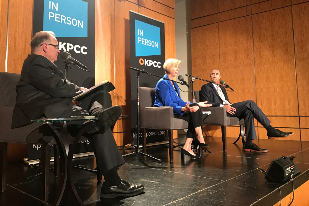 Candidates Janice Hahn and Steve Napolitano on stage with KPCC's Larry Mantle (far left) during an AirTalk debate in Cerritos for the Los Angeles County Board of Supervisors District 4 seat.