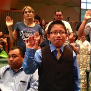 Luis Litez, a 10-year-old originally from Mexico, takes the oath of citizenship at a special kids' naturalization ceremony in downtown Los Angeles.