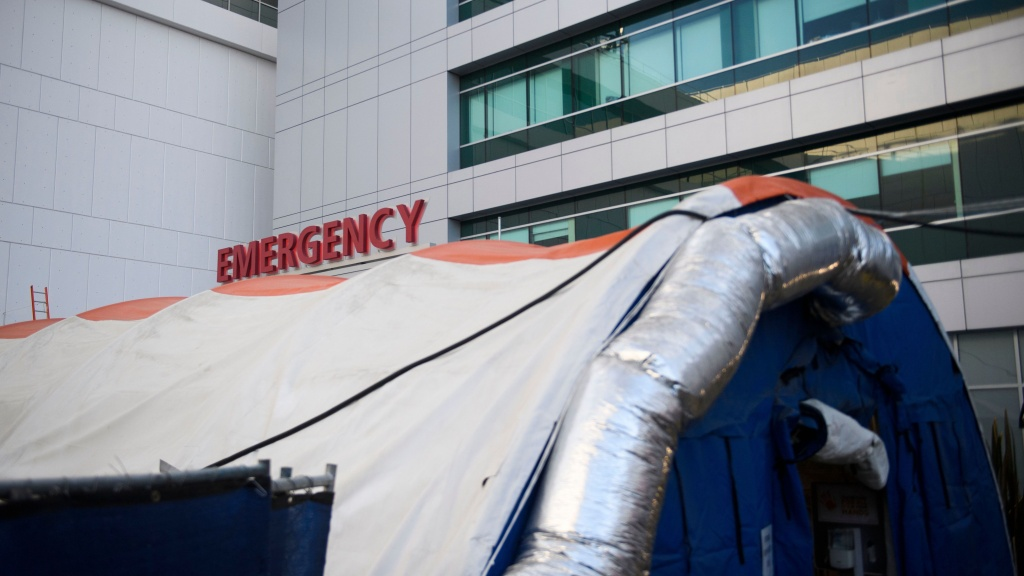 A field hospital tent stands outside the emergency department of the Martin Luther King Jr. Community Hospital earlier this month in Los Angeles. California is returning to a tiered restriction system.