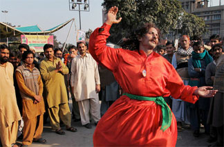 A Pakistani Sufi Muslim dances outside the Data Darbar, shrine to the patron saint of Lahore, during a three-day annual religious festival in Lahore, Feb. 4, 2010. Gatherings at the shrine have been curtailed since July, when suicide bombers killed more than 40 worshippers there.