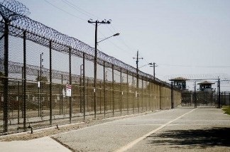 The California Institution for Men prison fence is seen in Chino, California.