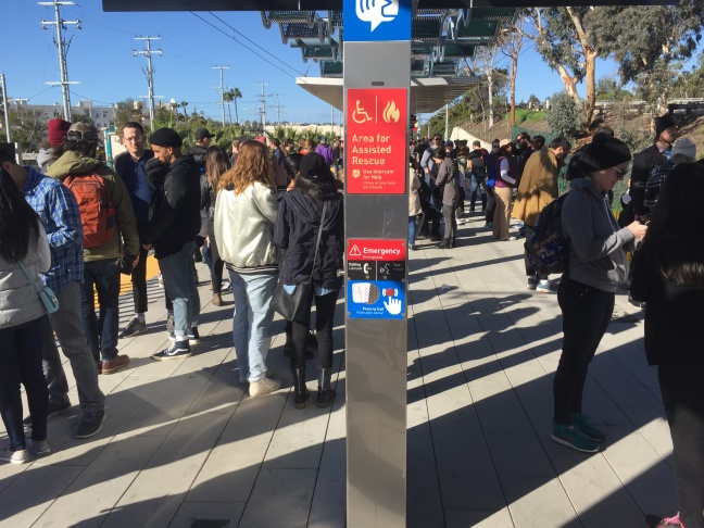 Long lines of people waiting to buy TAP cards at the Vermont/Sunset Red Line station.