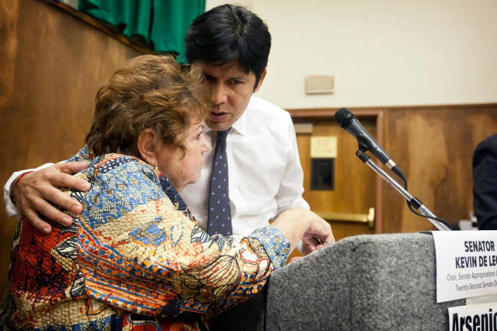 Teresa Marquez, president of the Boyle Heights Stakeholders Association, talks with Senator Kevin De Leon during one of many town hall meetings about the lead contamination around the former Exide battery recycling plant.