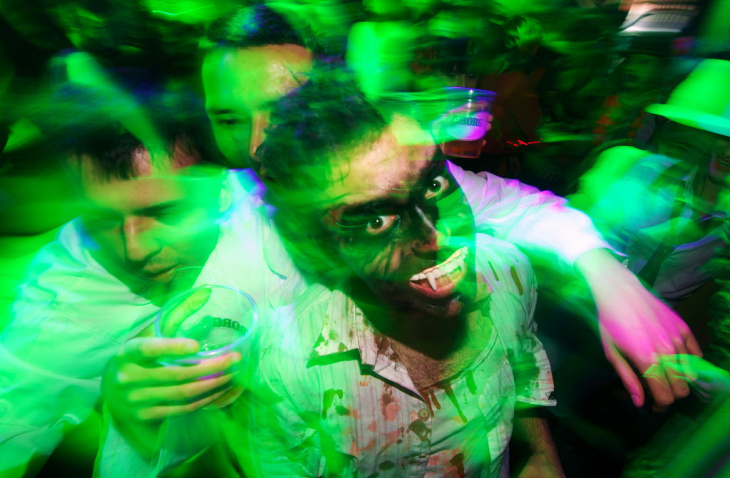 People dressed up as zombies during a Halloween Eve Party in Belgrade on October 30, 2011.  Halloween is based on the Celtic festival of Samhain and the ancient Celts believed the border between this world and the otherworld became thin on that night, allowing spirits to pass through.