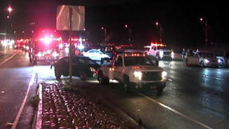 A tow truck removes a vehicle involved in a crash on a rain slickened 101 Freeway early Friday morning.
