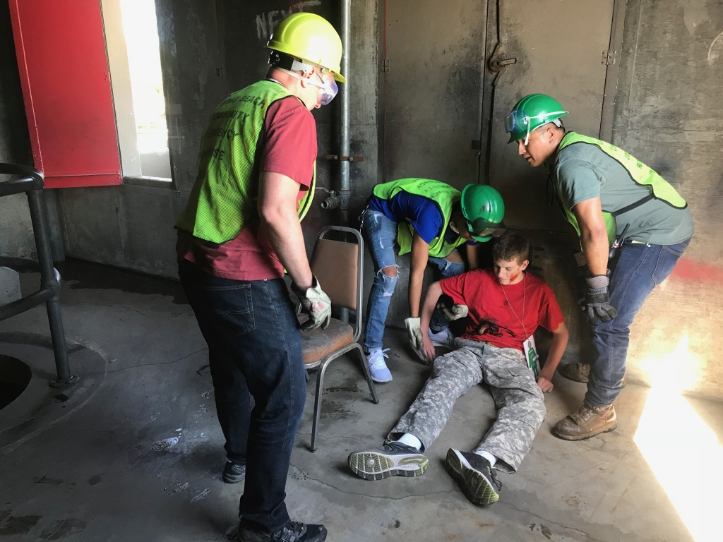 CERT trainees find Christian Smith and carrying him out of the building to safety and medical help at the triage center they have set up. Photo credit: Audrey Alden