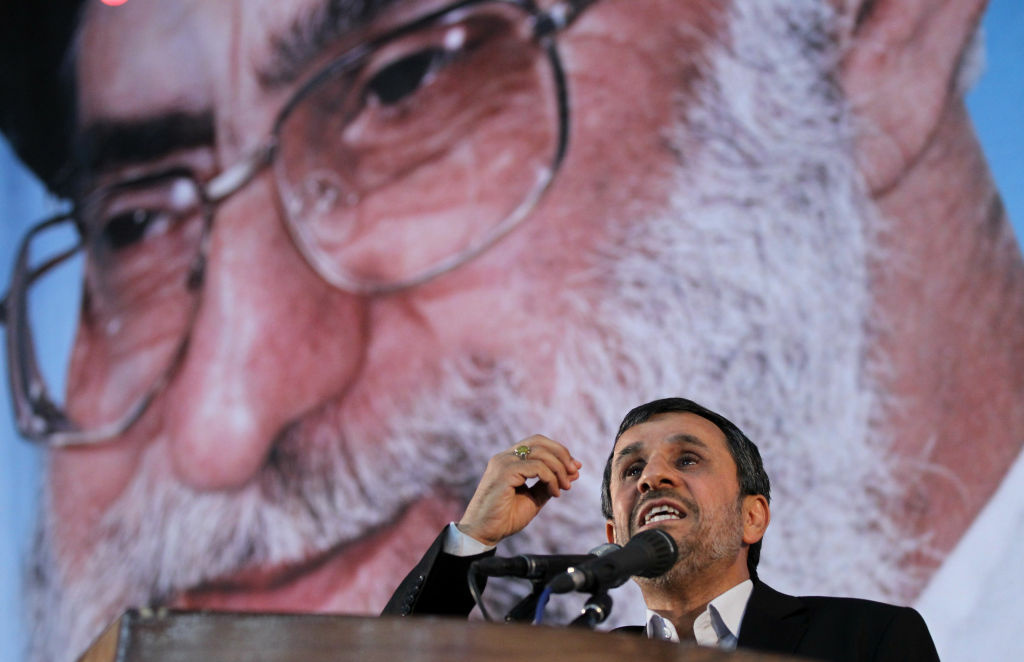 Iranian President Mahmoud Ahmadinejad delivers a speech under a portrait of Iran's supreme leader, Ayatollah Ali Khamenei, on June 2.