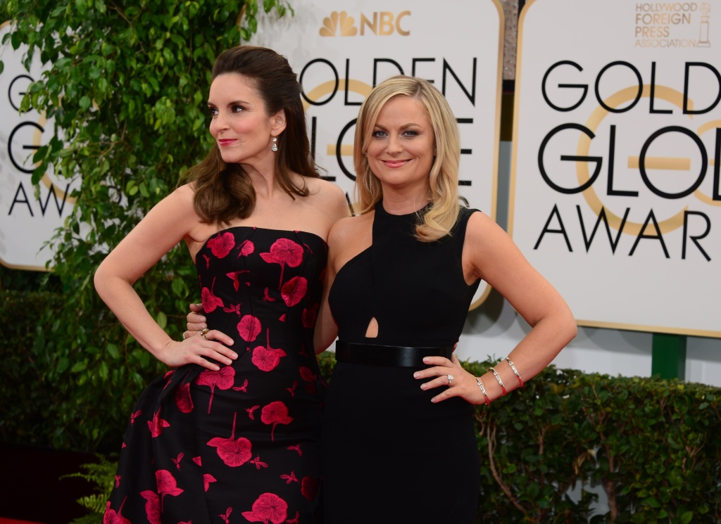Tina Fey (L) and Amy Poehler arrive on the red carpet for the Golden Globe awards on January 12, 2014 in Beverly Hills, California.