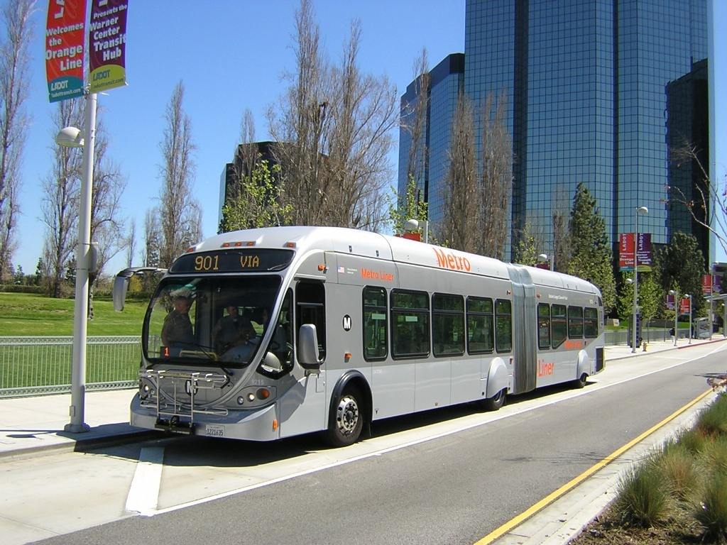 In a file photo, an Orange Line Metro bus stops at Warner Center.