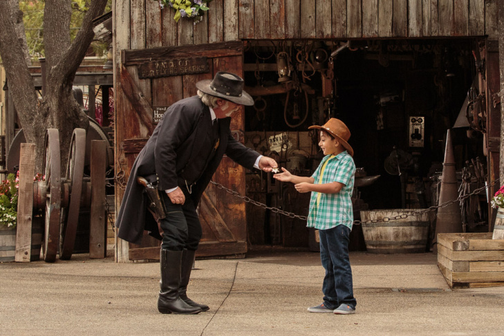 The sheriff of Calico deputizes a guest at Knott's Berry Farm's Ghost Town Alive attraction.