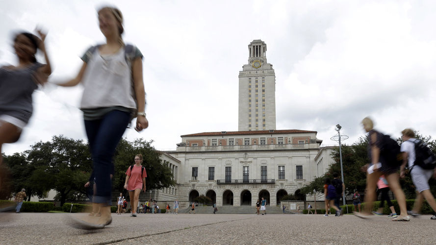 Students walk through the University of Texas, Austin, campus near the school's iconic tower on Sept. 27.