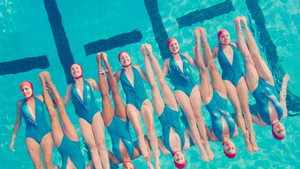 Synchronized swimming group the Aqualillies channels old Hollywood glamour.