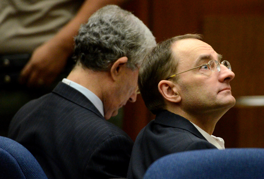 Defendant Christian Gerhartsreiter (right) from Germany sits during jury selection for his murder trial at Los Angeles Superior Court on March 15, 2013, in Los Angeles. Gerhartsreiter, the alleged Rockefeller impostor, is accused of killing his landllord, John Sohus, in February 1985.