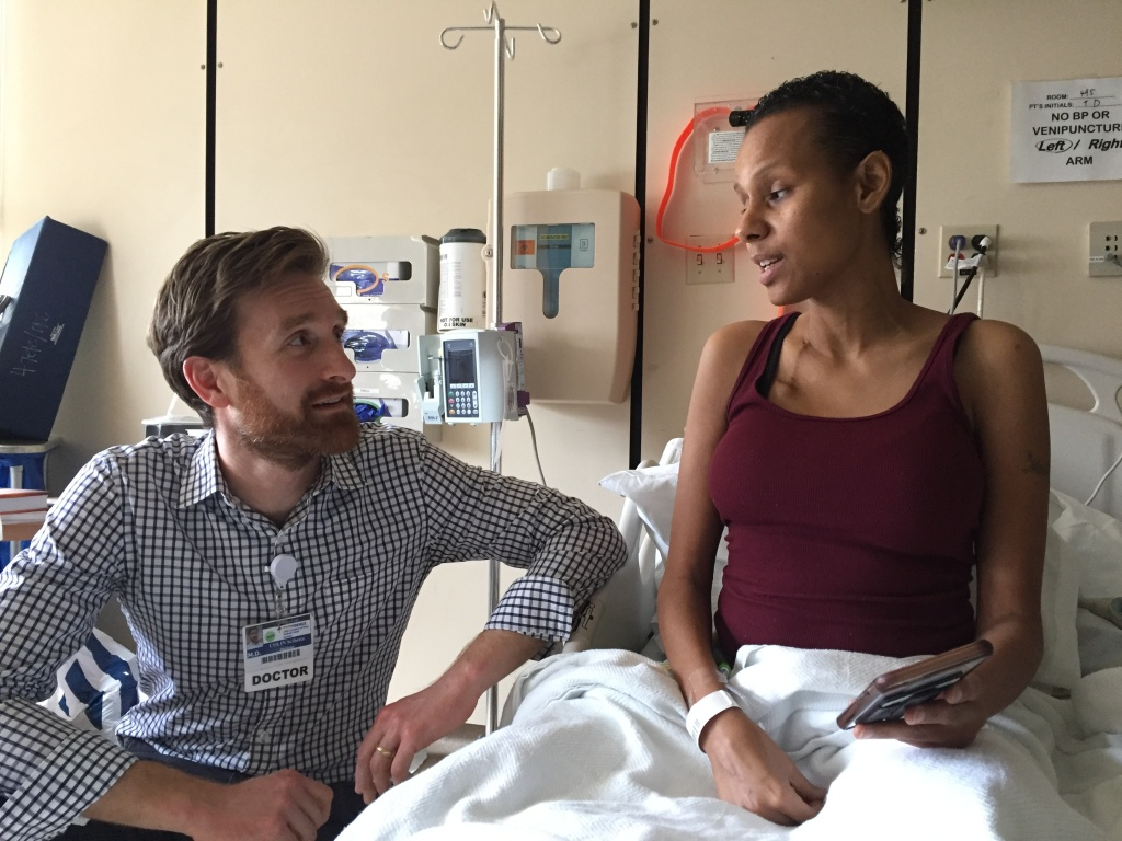 Tenesha Depaz, 40, talks to her palliative care doctor, Collin Scibetta.