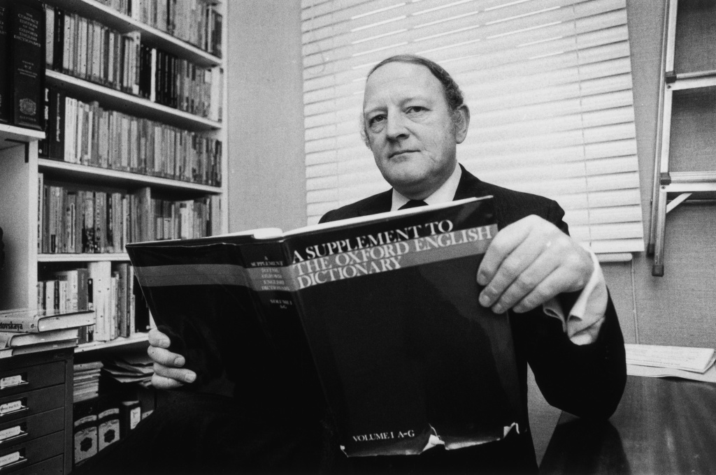 English writer and broadcaster Robert Robinson holding the first volume of 'A Supplement To The Oxford English Dictionary', 24th March 1977 —long before Wikipedia and Wiktionary put the practice of curating language and knowledge in the hands of the Internet-connected masses and before words like