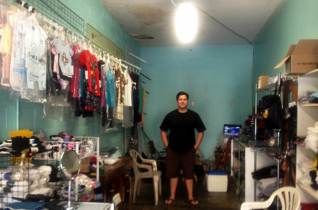 Juan Gonzalez at Family Fashion Clothing is concerned about what will happen to his business when a new WalMart moves in nearby.