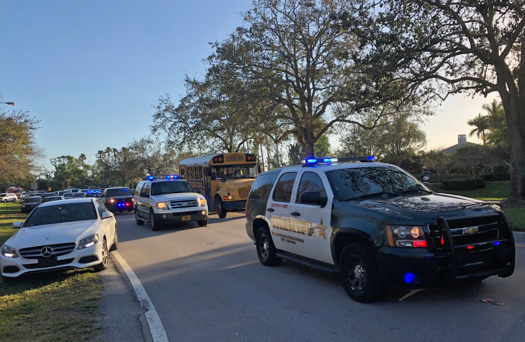 Sheriff vehicles are seen at Marjory Stoneman Douglas High School in Parkland, Florida, a city about 50 miles (80 kilometers) north of Miami on February 14, 2018 following a school shooting.
